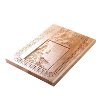 Cribbage board with lighthouse on a cliff design.