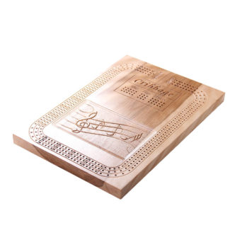 Cribbage board with musical notes design.