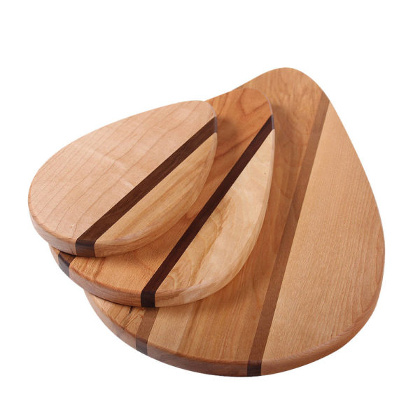 Family of accent raindrop cutting boards, small, medium, large, in various woods.